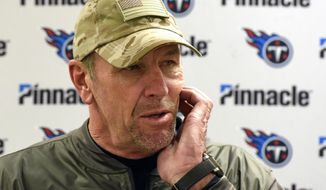 Tennessee Titans coach Mike Mularkey answers a question early Friday, Nov. 17, 2017, following an NFL football game against the Pittsburgh Steelers in Pittsburgh on Thursday. The Steelers won 40-17. (AP Photo/Don Wright)