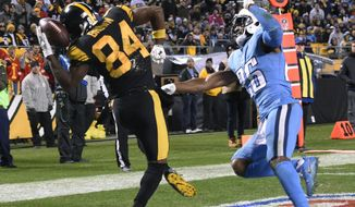 Pittsburgh Steelers wide receiver Antonio Brown (84) comes down with a touchdown reception as Tennessee Titans cornerback Logan Ryan (26) defends during the second half of an NFL football game in Pittsburgh, Thursday, Nov. 16, 2017. (AP Photo/Don Wright)
