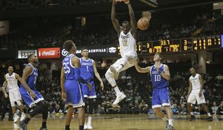 Vanderbilt's Djery Baptiste (12) dunks against UNC-Asheville during the first half of an NCAA college basketball game in Nashville, Friday, Nov. 17, 2017. (AP Photo/Mark Humphrey)