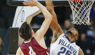Villanova guard Mikal Bridges deflects the basketball shot by Lafayette guard Eric Stafford during the first half of an NCAA college basketball game Friday, Nov. 17, 2017, in Allentown, Pa. (Yong Kim/The Philadelphia Inquirer via AP)