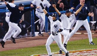 FILE - In this Oct. 16, 2003, file photo, New York Yankees' Aaron Boone, center, celebrates after hitting a solo home run in the 11th inning to beat the Boston Red Sox in Game 7 of the American League Championship Series in New York. Boone became the first person with no experience as a manager of coach to interview to become Joe Girardi's successor with the New York Yankees. The 44-year-old interviewed Friday, Nov. 17, 2017, becoming the fourth to go through the process after Yankees bench coach Rob Thomson, former Cleveland and Seattle manager Eric Wedge, and San Francisco bench coach Hensley Meulens. (AP Photo/Bill Kostroun, File)