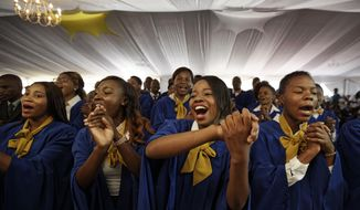 The choir sings as Zimbabwe's President Robert Mugabe presides over a student graduation ceremony at Zimbabwe Open University on the outskirts of Harare, Zimbabwe Friday, Nov. 17, 2017. Mugabe is making his first public appearance since the military put him under house arrest earlier this week. (AP Photo/Ben Curtis)