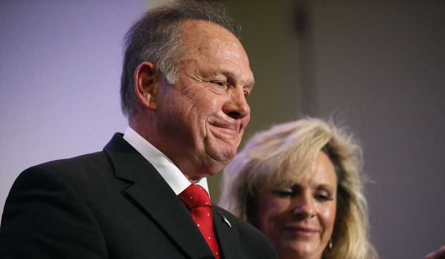 "In this Nov. 16, 2017, photo, former Alabama Chief Justice and U.S. Senate candidate Roy Moore speaks at a news conference in Birmingham, Ala., with his wife Kayla Moore, right. A sex scandal has relegated Moore's hard-line positions on LGBT issues to the background in Alabama's turbulent Senate race even as religious activists blame the ""LGBT mafia"" and ""homosexualist gay terrorism"" for his precarious political plight. (AP Photo/Brynn Anderson)"