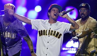 """In this Sunday, June 25, 2017, file photo, Bruno Mars performs """"Perm"""" at the BET Awards at the Microsoft Theater in Los Angeles. (Photo by Matt Sayles/Invision/AP, File)"""