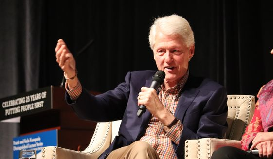 Former President Bill Clinton speaks at a gathering in Little Rock, Ark., on Saturday, Nov. 18, 2017, marking 25 years since his election. He and his wife Hillary Clinton appeared before about 2,600 people at the event in the Statehouse Convention Center. (AP Photo/Kelly P. Kissel)