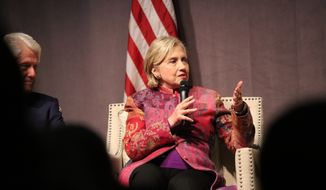 Former Secretary of State Hillary Clinton, accompanied by her husband former President Bill Clinton, speaks at a gathering in Little Rock, Ark., on Saturday, Nov. 18, 2017. The event marked 25 years since Bill Clinton was elected president. (AP Photo/Kelly P. Kissel)