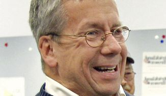 """In this Oct. 29, 2010, file photo, William O'Neill, an Ohio appeals court judge selected as the Democratic nominee for U.S. House of Representatives to represent Ohio's 14th District, laughs during a campaign stop at the Democratic party headquarters in Mentor, Ohio.  O'Neill tells The Associated Press on Saturday, Nov. 18, 2017,  he agreed with a commenter to his post made Friday that it was """"insensitive"""" because identities of the women could be traced. The post caused a furor, leading to condemnation by members of both parties, the court's chief justice and prompting his campaign manager to quit. (AP Photo/Amy Sancetta, File) **FILE**"""