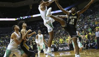 Oregon's Kenny Wooten rejects a dunk attempt by Alabama State guard Reginald Gee during Oregon's 114-56 victory in an NCAA college basketball game in Eugene, Ore., Friday, Nov. 17, 2017. (Brian Davies/The Register-Guard via AP)