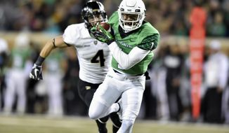 North Texas wide receiver Turner Smiley (1) catches a pass and scores a touchdown against the Army defense during an NCAA college football game Saturday, Nov. 18, 2017, in Denton, Texas. (Jeff Woo/The Denton Record-Chronicle via AP)
