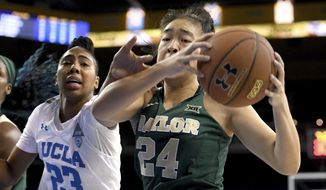 Baylor's Natalie Chou (24) grabs a rebound from UCLA's Kelli Hayes (23) during the first half of an NCAA college basketball game in Los Angeles, Saturday, Nov. 18, 2017. (AP Photo/Michael Owen Baker)