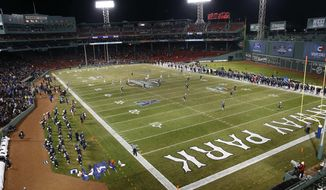 Boston College kicks off against Connecticut during the first quarter of an NCAA college football game at Fenway Park in Boston, Saturday, Nov. 18, 2017. (AP Photo/Michael Dwyer)