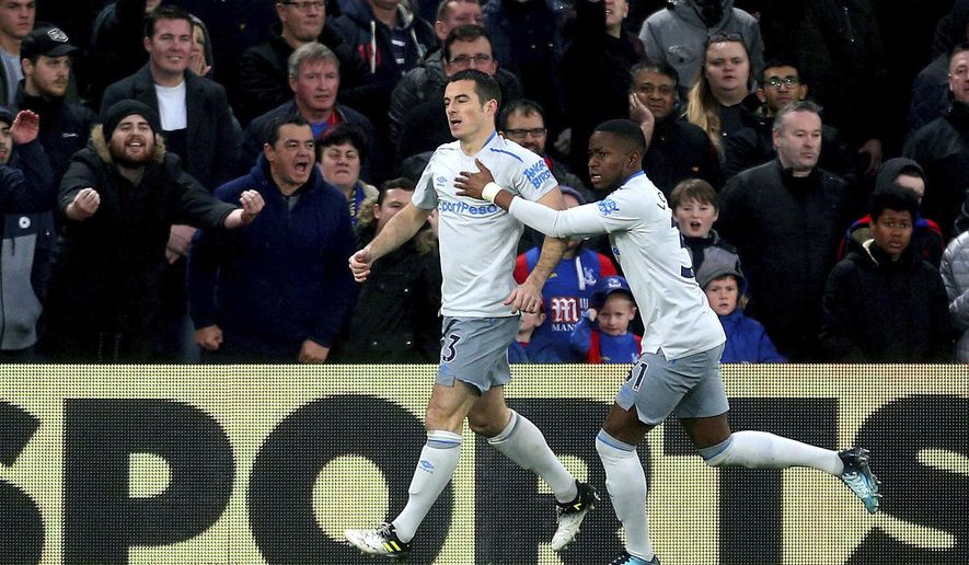 Everton's Leighton Baines, left, celebrates scoring his side's first goal of the game during the English Premier League soccer match Crystal Palace versus Everton at Selhurst Park, London, Saturday Nov. 18, 2017. (Steven Paston/PA via AP)