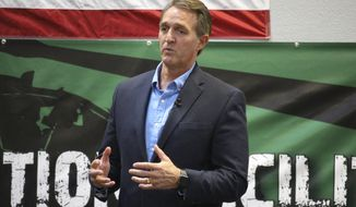 U.S. Sen. Jeff Flake, R-Ariz., speaks to aerospace workers about the current congressional tax reform proposal in Mesa, Ariz., Friday, Nov. 17, 2017. The Republican told aerospace company workers that corporate tax cuts are needed to restore America's global competitiveness. (AP Photo/Bob Christie)