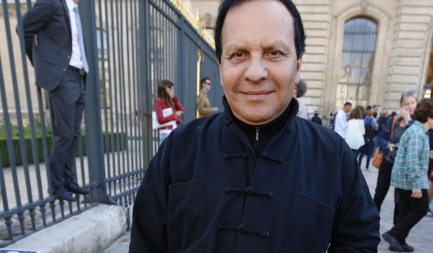 FILE - A Friday, Sept. 26, 2014 file photo of Tunisian-born fashion designer Azzedine Alaia arriving at Christian Dior's Spring/Summer 2015 ready-to-wear fashion collection presented in Paris, France. Alaia, an iconoclast whose clingy dresses marked the 1980s and who dressed famous women from Hollywood to the White House, has died at age 77. The French Haute Couture Federation announced Alaia's death on Saturday, Nov. 18, 2017, without providing details. (AP Photo/Francois Mori, File)