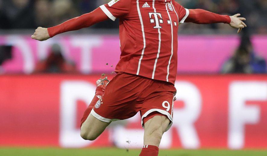 Bayern's Robert Lewandowski tries to score during the German Soccer Bundesliga match between FC Bayern Munich and FC Augsburg in Munich, Germany, Saturday, Nov. 18, 2017. (AP Photo/Matthias Schrader)