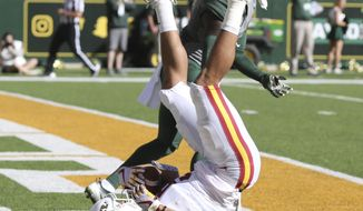 Iowa State wide receiver Allen Lazard (5) lands in the end zone while scoring over Baylor safety Taion Sells (2) in the first half of a NCAA college football game, Saturday, Nov. 18, 2017, in Waco, Texas. (Rod Aydelotte/Waco Tribune Herald, via AP)