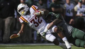 Iowa State running back David Montgomery, left, is pulled down by Baylor linebacker Jordan Williams, right, in the first half of a NCAA college football game, Saturday, Nov. 18, 2017, in Waco, Texas. (Rod Aydelotte/Waco Tribune Herald, via AP)