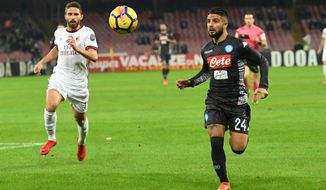 Napoli's Lorenzo Insigne, right, and Milan's Fabio Borini vie for the ball during the Italian Serie A soccer match between Napoli and AC Milan, at the San Paolo stadium in Naples, Italy, Saturday, Nov. 18 2017. (Ciro Fusco/ANSA via AP)