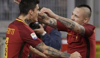 Roma's Diego Perotti, left, celebrates with teammate Radia Nainggolan, after scoring first goal during an Italian Serie A soccer match between AS Roma and Lazio, at the Olympic stadium in Rome, Saturday, Nov. 18, 2017. (AP Photo/Andrew Medichini)