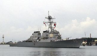 In this Aug. 8, 2016, file photo, the guided-missile destroyer USS Benfold arrives at the port in Qingdao, China. (AP Photo/Borg Wong, File)