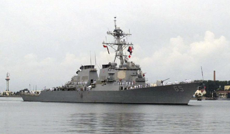 FILE - In this Aug. 8, 2016, file photo, the guided missile destroyer USS Benfold arrives at port in Qingdao, China. According to the U.S. Navy 7th Fleet, a Japanese tug boat lost propulsion and drifted into the USS Benfold during a towing exercise in Sagami Bay on Saturday, Nov. 18, 2017. (AP Photo/Borg Wong, File)