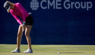 Michelle Wie putts on the 18th hole during the third round of the CME Group Tour Championship golf tournament at Tiburon Golf Club, Saturday, Nov. 18, 2017 in Naples, Fla. (Luke Franke/Naples Daily News via AP)