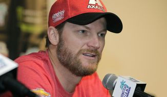 Dale Earnhardt Jr. speaks with the media during a news conference before Sunday's NASCAR Cup Series auto race at Homestead-Miami Speedway in Homestead, Fla., Friday, Nov. 17, 2017. Earnhardt is at peace with his decision to retire as he straps into the No. 88 Chevrolet for the final time in his NASCAR Cup career on Sunday. The 43-old Earnhardt has Homestead-Miami Speedway stamped as the final spot in his farewell tour.   (AP Photo/Terry Renna)