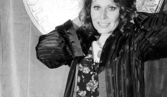 """FILE - In this June 4, 1978 file photo, actress Ann Wedgeworth poses at Sardi's restaurant following the 32nd Annual Tony Awards in New York City where she won best actress in a featured role for her performance in """"Chapter Two."""" Wedgeworth, who gained fame on film and Broadway before taking on the role of a flirty divorcee on """"Three's Company,"""" has died in New York at age 83. (AP Photo/File)"""