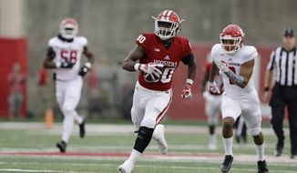 Indiana's Ian Thomas (80) runs for a 57-yard touchdown reception during the first half of an NCAA college football game against Rutgers, Saturday, Nov. 18, 2017, in Bloomington, Ind. (AP Photo/Darron Cummings)