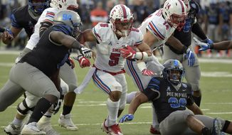 SMU running back Xavier Jones (5) carries the ball against Memphis defensive lineman Joseph Dorceus (94) in the second half of an NCAA college football game Saturday, Nov. 18, 2017, in Memphis, Tenn. (AP Photo/Brandon Dill)