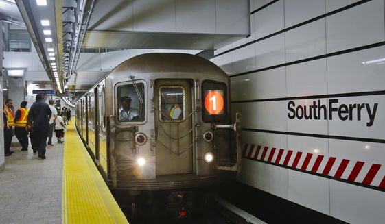 In this June 27, 2017 file photo, the No. 1 subway train pulls into the South Ferry Station in New York. (AP Photo/Bebeto Matthews)