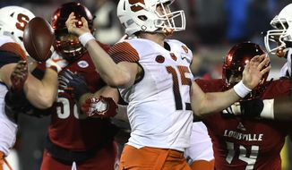 Syracuse quarterback Rex Culpepper (15) loses his grip on the ball as he attempts a pass during the second half of an NCAA college football game against Louisville, Saturday, Nov. 18, 2017, in Louisville, Ky. Louisville won 56-10. (AP Photo/Timothy D. Easley)
