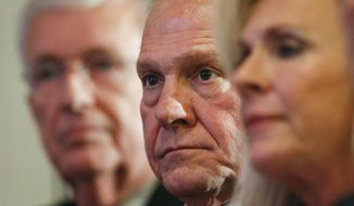 FILE - In this Thursday, Nov. 16, 2017 file photo, former Alabama Chief Justice and U.S. Senate candidate Roy Moore waits to speak at a news conference in Birmingham, Ala. (AP Photo/Brynn Anderson)