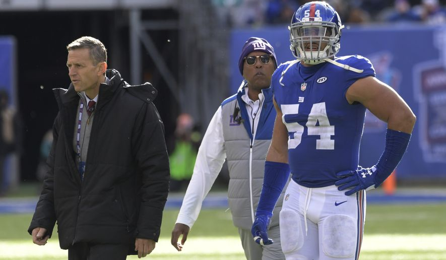 New York Giants' Olivier Vernon (54) is helped off the field during the first half of an NFL football game against the Kansas City Chiefs Sunday, Nov. 19, 2017, in East Rutherford, N.J. (AP Photo/Bill Kostroun)