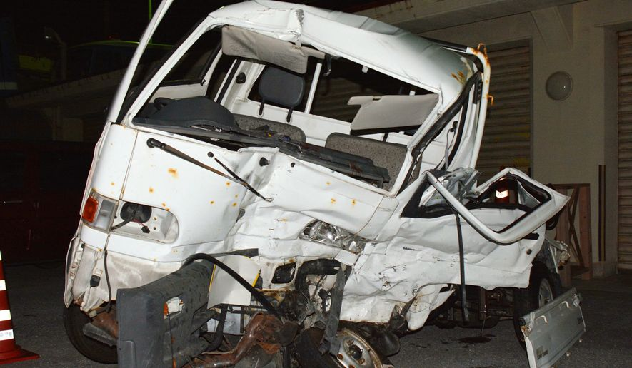 A Japanese driver's damaged vehicle is placed at a police station in Naha, Okinawa, southern Japan Sunday, Nov. 19, 2017. Police on the southern Japanese island of Okinawa are investigating a fatal traffic accident that occurred Sunday when a truck driven by a U.S. Marine collided with the small truck at an intersection, killing the Japanese driver of the other vehicle. (Kazuki Sawada/Kyodo News via AP)