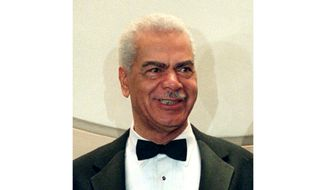 "In this Feb. 3, 1997, file photo, Earle Hyman poses before an induction to the Theater Hall of Fame at the Gershwin Theatre in New York. Hyman, a veteran actor of stage and screen who was widely known for playing Russell Huxtable on ""The Cosby Show,"" has died. Strohl, a representative for The Actors Fund, says that Hyman died Friday, Nov. 17, 2017, at the Lillian Booth Actors Home in Englewood, New Jersey. He was 91. (AP Photo/Ron Frehm, File)"