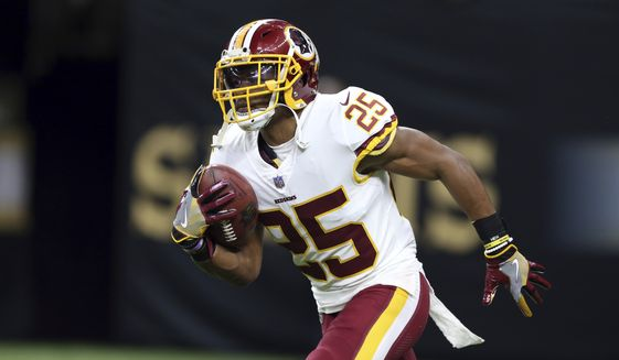 Washington Redskins running back Chris Thompson (25) warms up before an NFL football game against the New Orleans Saints in New Orleans, Sunday, Nov. 19, 2017. (AP Photo/Rusty Costanza)