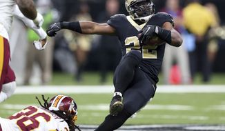 New Orleans Saints running back Mark Ingram (22) is tripped up by Washington Redskins free safety D.J. Swearinger (36) in the first half of an NFL football game in New Orleans, Sunday, Nov. 19, 2017. (AP Photo/Rusty Costanza)