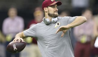 Washington Redskins quarterback Kirk Cousins warms up before an NFL football game against the New Orleans Saints in New Orleans, Sunday, Nov. 19, 2017. (AP Photo/Rusty Costanza)