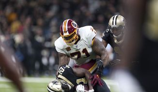 New Orleans Saints cornerback De'Vante Harris (21) tries but fails to hold onto a near interception as Washington Redskins offensive tackle Trent Williams (71) brings him down in the first half of an NFL football game in New Orleans, Sunday, Nov. 19, 2017. (AP Photo/Rusty Costanza) **FILE**