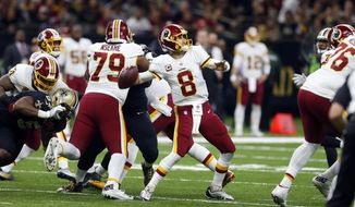 Washington Redskins quarterback Kirk Cousins (8) drops back to pass in the second half of an NFL football game against the New Orleans Saints in New Orleans, Sunday, Nov. 19, 2017. (AP Photo/Butch Dill)