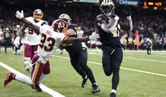 New Orleans Saints running back Alvin Kamara (41) scores a two-point conversion past Washington Redskins free safety DeAngelo Hall (23) to tie the game in the second half of an NFL football game in New Orleans, Sunday, Nov. 19, 2017. (AP Photo/Rusty Costanza)