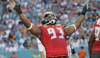 Tampa Bay Buccaneers defensive tackle Gerald McCoy (93) celebrates a play, during the first half of an NFL football game against the Miami Dolphins, Sunday, Nov. 19, 2017, in Miami Gardens, Fla. (AP Photo/Lynne Sladky)