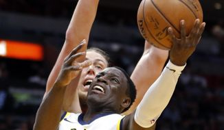 Indiana Pacers guard Darren Collison (2) goes to the basket as Miami Heat center Kelly Olynyk (9) defends in the first quarter of an NBA basketball game, Sunday, Nov. 19, 2017, in Miami. (AP Photo/Joe Skipper)