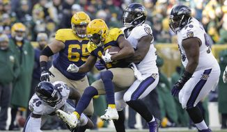 Green Bay Packers quarterback Brett Hundley is sacked by Baltimore Ravens' Matt Judon during the first half of an NFL football game Sunday, Nov. 19, 2017, in Green Bay, Wis. (AP Photo/Jeffrey Phelps)