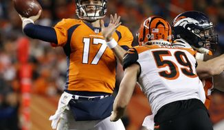 Denver Broncos quarterback Brock Osweiler (17) throws as Cincinnati Bengals outside linebacker Nick Vigil (59) pursues during the second half of an NFL football game, Sunday, Nov. 19, 2017, in Denver. (AP Photo/Jack Dempsey)