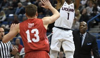 Connecticut's Christian Vital shoots over Boston University's Will Goff during the first half of an NCAA college basketball game, Sunday, Nov. 19, 2017, in Hartford, Conn. (AP Photo/Jessica Hill)