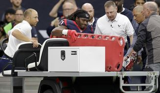 Houston Texans running back D'Onta Foreman (27) is taken off the field on a cart after he was injured during a touchdown run against the Arizona Cardinals during the second half of an NFL football game, Sunday, Nov. 19, 2017, in Houston. (AP Photo/David J. Phillip)