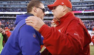 New York Giants head coach Ben McAdoo, left, shakes hands with Kansas City Chiefs head coach Andy Reid, right, after an NFL football game Sunday, Nov. 19, 2017, in East Rutherford, N.J. (AP Photo/Kathy Willens)