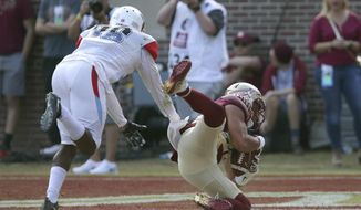 Florida State's Justin Motlow pulls in a touchdown pass against Delaware State's Devin Smith in the fourth quarter of an NCAA college football game, Saturday, Nov. 18, 2017, in Tallahassee Fla. Florida State won 77-6. (AP Photo/Steve Cannon)